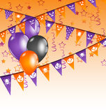 Hanging flags and balloons for Halloween party Stock Photography