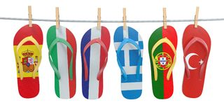 Hanging flip flops in colors of  different mediterranean europea Royalty Free Stock Image