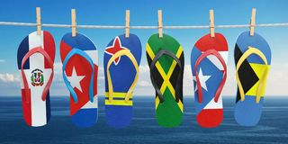 Hanging flip flops in colors of flags of different carribean cou Stock Images