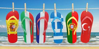 Hanging flip flops in colors of flags of  different mediterranea Royalty Free Stock Photo