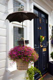 Hanging flower basket. Outdoor hanging flower basket in front of house Royalty Free Stock Images
