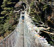Hanging footbridge ower the dudh koshi nadi river Stock Photography