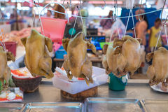 Hanging fresh raw chicken meat prepare to sell. In the market Stock Photo