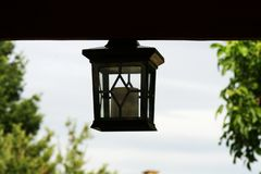Hanging garden lamp sky background stock photography