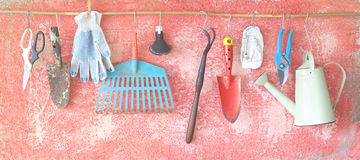 Hanging gardening tools. Old gardening tools,hanging on a rustic wall. Springtime gardening concept, Large size panoramic format, excellent sharpness Stock Photos