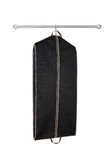 Hanging garment bag. A black hanging garment bag on a pole Royalty Free Stock Photography