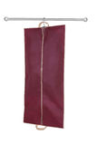 Hanging garment bag. A red hanging garment bag on a pole Royalty Free Stock Photography