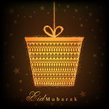 Hanging gift box for Islamic festival, Eid celebration. Beautiful golden hanging gift box on stars decorated brown background for Islamic holy festival, Eid Royalty Free Stock Photos