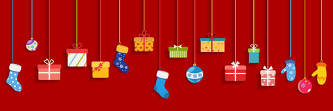 Hanging gift boxes, socks, mittens and christmas balls Royalty Free Stock Photos