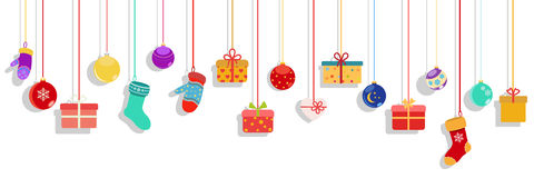 Hanging gift boxes, socks, mittens and christmas balls Royalty Free Stock Photography