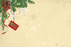 Hanging Gift Card. Holiday gift card with pine bough and icicles on snowflake background Stock Photo