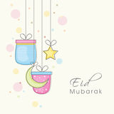 Hanging gifts, moon and star for Eid festival celebration. Elegant greeting card design decorated with hanging gifts, crescent moon and star for famous Islamic Royalty Free Stock Image