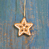 Hanging gingerbread or cookies star on wooden background for chr Royalty Free Stock Photography