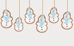 Hanging gingerbread snowmans cookies Stock Photos