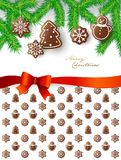 Hanging gingerbread sweets with Merry Christmas wishes Royalty Free Stock Photography