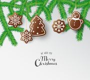 Hanging gingerbread sweets with Merry Christmas wishes Stock Image