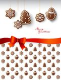 Hanging gingerbread sweets with Merry Christmas wishes. Royalty Free Stock Photo