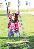 Hanging girl on swing Royalty Free Stock Image