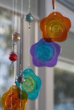 Hanging glass decoration. Colorful glass hanging flower and bead light-catcher Royalty Free Stock Images
