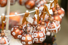 Hanging glittering Christmas decorations bulbs Stock Photos