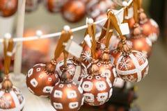 Hanging glittering Christmas decorations bulbs Stock Photos