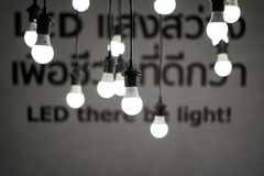 Hanging glowing light bulbs from ceiling. IKEA Thailand, Jun 3, 2017: Hanging glowing light bulbs from ceiling with depth of field against blurred background Royalty Free Stock Photography