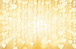 Hanging gold heart shapes and bokeh lights. Computer generated abstract romantic background Royalty Free Stock Image