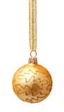 Hanging golden christmas ball with ribbon isolated Stock Images