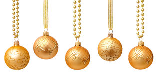Hanging golden christmas balls with ribbon isolated Stock Images