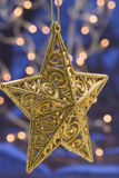 Hanging golden Christmas star Royalty Free Stock Photography