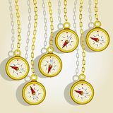 Hanging golden compasses Royalty Free Stock Photography