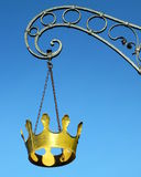 Hanging golden crown. The crown hangs at an old house in the old town of ratingen, Germany royalty free stock images