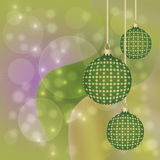 Hanging Green and Gold Christmas Baubles Stock Photos