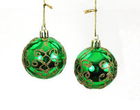 Hanging Green and Gold Christmas Tree Balls Royalty Free Stock Photography