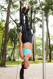 Hanging on gymnastic rings Royalty Free Stock Photo