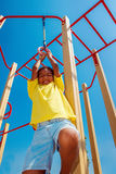 Hanging on gymnastic rings. Boy hanging on gymnastic rings at the playground Royalty Free Stock Photos