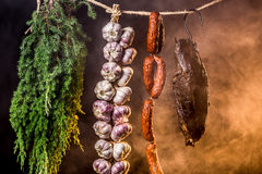 Hanging ham in the smokehouse Royalty Free Stock Photo
