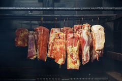 Hanging ham in the smokehouse Royalty Free Stock Image