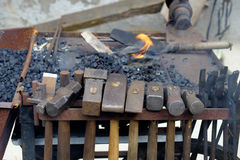 Hanging hammers at the forge cart from a blacksmith stock photo