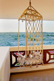 Hanging hammock chair and horizon line Royalty Free Stock Photography