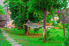 Hanging a hammock on the patio at  villa Royalty Free Stock Photography