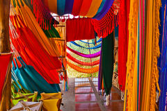 Colorful Hammocks. The vivid colors of hanging hammocks in a roadside shop along the Ruta del Sol coastal route of Ecuador Stock Images