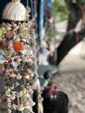 Hanging handmade decoration of shells in Thailand, marine decor stock images