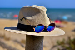 Hanging hat with sunglasses. Hat with sunglasses hanging by the end of summer Stock Photography