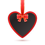 Hanging heard shape card with red bow. Stock Photo