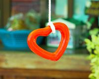 Hanging heart. In the garden stock images