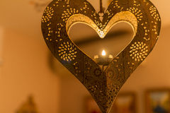 Hanging heart-shaped candle light Stock Photography