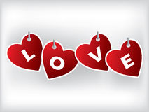 Hanging heart shaped labels Royalty Free Stock Images