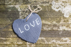 Hanging heart and wooden background in country style. Hanging heart and wooden background in country style - greeting card royalty free stock photos