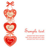 Hanging hearts. Cute hanging Valentine hearts connected with ribbons Stock Image